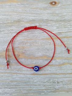 Evil eye bracelet with red string and macrame knot Hey, I found this really awesome Etsy listing at https://www.etsy.com/listing/512378381/evil-eye-bracelet-red-string-bracelet