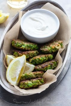 Pea and Feta Fritters with Yogurt Mint Dipping Sauce | gourmandeinthekitchen.com
