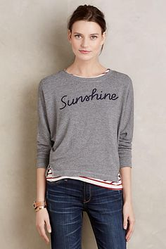 """Sunshine Sweatshirt - anthropologie.com: Another quirky sweatshirt. I don't usually buy clothes with words on them, but I love the irony of """"sunshine"""" in a pretty font on a dull gray sweatshirt."""