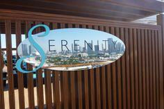 Serenity Deck sign with Miami skyline reflection- Carnival Breeze
