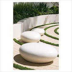 White pebble seats in The Cancer Research UK Garden, sponsored by Cancer Research - Silver-Gilt Flora medal winner at RHS Chelsea Flower Show 2009