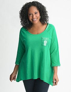 Sequin trim adds a sparkling new twist on our flattering shark bite top. Easy-wearing knit top is made to show off your shape with a trendy long length and slimming silhouette. Sequin trim dazzles at the scoop neckline, chest pocket and cuffed 3/4 sleeves. lanebryant.com