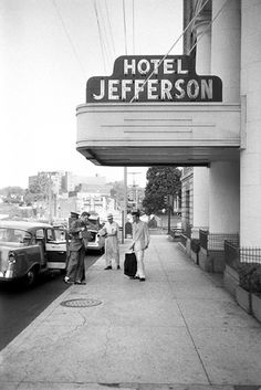Elvis and Junior Smith entering The Hotel Jefferson by Alfred Wertheimer | Elvis and his cousin/gofer Junior Smith arrive at the Hotel Jefferson. He is in Richmond to perform that evening on the Elvis Presley Show at the Mosque Theatre. Richmond VA. June 30, 1956.