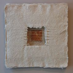 "Claudia Lee.   Passages: Window 1  Handmade paper of Belgian flax, hand-spun sisal window with rust print, hand-stitched linen thread  17"" x 17""  ."
