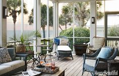 This Florida vacation home's screened porch faces the Gulf of Mexico. Decorator Tammy Connor furnished it with an antique wicker sofa and assorted chairs that she unified by painting a deep, cloudy blue.