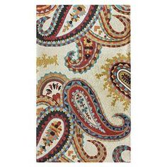 Ivory wool rug with a multicolor paisley motif. Hand-tufted in India.   Product: RugConstruction Material: 100% WoolColor: IvoryFeatures:  Made in IndiaHand-tufted  Note: Please be aware that actual colors may vary from those shown on your screen. Accent rugs may also not show the entire pattern that the corresponding area rugs have.Cleaning and Care: These rugs can be spot treated with a mild detergent and water. Professional cleaning is recommended if necessary.