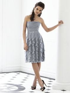 After Six Bridesmaid Style 6649  Strapless cocktail length lux chiffon dress w/ rouched bodice and vertical bias ruffle skirt. Lux chiffon covered silver sequin belt always matches dress. Sizes available 00-30W, and 00-30W extra length.
