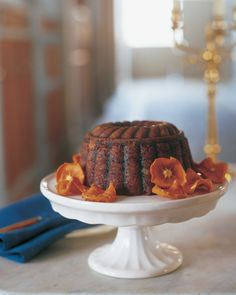 Steamed pudding is a traditional and festive holiday dessert. Persimmons, golden raisins, cinnamon, and nutmeg make the pudding spicy-sweet, while Calvados adds kick.