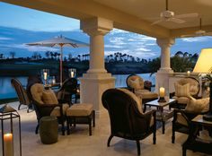 The expansive loggia and second-floor terrace of golf legend Raymond Floyd and wife Maria's golf cottage overlooks the 18th hole of Old Palm Golf Club in Palm Beach Gardens, Fla