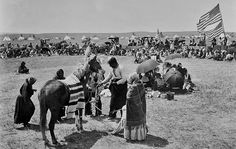 Assiniboine group during a Give-away on the Fort Belknap Reservation in Montana - 1900