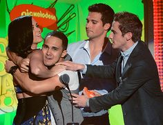 Katy Perry, Carlos Pena Jr., Logan Henderson and Kendall Schmidt of Big Time Rush speak onstage during Nickelodeons 26th Annual Kids Choice Awards.