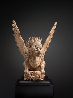 "Garuda Lion Mythical Beast Bali, Indonesia Wood Early 20th Century 26h x 20w x 26d "" 66 x 51 x 66 centimeters A powerful yet aesthetic rendering of a garuda-lion, a classic animal totem of Balinese cosmology"