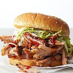 Be the star of your next potluck with melt-in-your-mouth-tender pulled pork sandwiches. Lightly seasoned and layered with shredded cabbage, these braised pork sandwiches are surprisingly healthy: just 295 calories per serving! Healthy Potluck, Healthy Pork Recipes, Potluck Recipes, Dinner Recipes, Cooking Recipes, Potluck Ideas, Roast Recipes, Party Recipes, Sandwich Au Porc