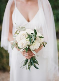 White Zinnia Bouquet with Olive Leaf | Brides.com