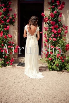Gorgeous lace bodice sexy backless with silk chiffon skirt and sash wedding dress