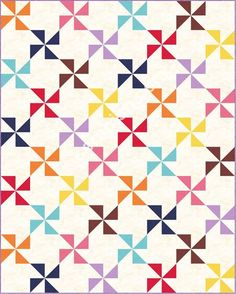 This easy pinwheel quilt pattern uses 2 charm packs for a twin size quilt and one to make a pinwheel baby quilt pattern. Make it today!