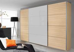 Schrank Quadra 315,0 cm Buche Weiß 8627. Buy now at https://www.moebel-wohnbar.de/schwebetuerenschrank-quadra-315-0-cm-buche-mit-glas-weiss-8627.html
