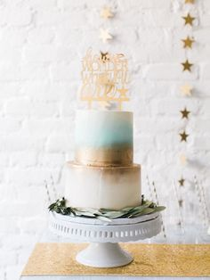 Two tier sky blue, white and gold cake: http://www.stylemepretty.com/living/2016/10/11/now-this-is-how-you-announce-the-gender-of-your-baby/ Photography: Bonnie Sen - http://bonniesen.com/