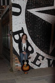 """Reagan James, """"Voice"""" contestant,  outside Old Texas Brewing Company in Burleson, Texas. Photo taken by Cindy Benjamin Redemann"""