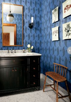 Inspired by the sea, sand and sky, Style at Home's design editor, Jessica Waks, transforms a tired cottage into a delightful retreat. The powder room wows with its blue and black wallpaper design, herringbone marble floors, statement pendant light and decorative trays mounted as art.