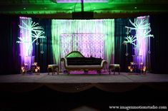 indian wedding reception decor stage purple green lighting http://maharaniweddings.com/gallery/photo/12020