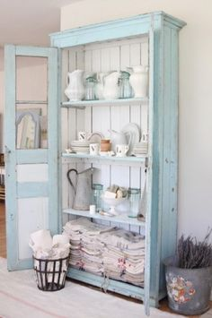 Sometimes just a simple cupboard can be the perfect place to display some dishes.  I love how the top of this piece had the panels on the doors replaced with some chicken wire!   *