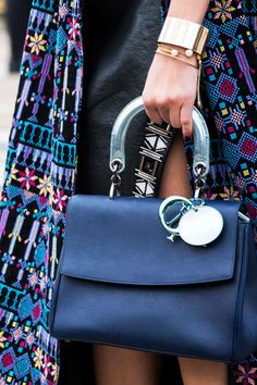 - Trade your black bag for a polished navy style instead.