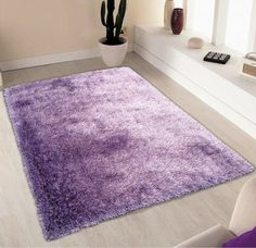 This collection features warm, rich tones in a single Soft Shaggy pattern. Hand-tufted superior high quality for a luxurious look in any living room space.It measures 2' x 3' ft. http://rugaddiction.com/collections/all-shag-rugs/products/solid-lavender