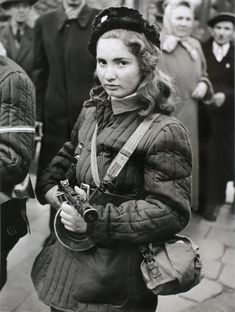 Young Hungarian, armed with a PPSh-41 Russian-made SMG, in the streets of Budapest as the Hungarian Revolution against Soviet communism unfolds in October 1956. Many of these irregular fighters suffered an unceremonious ending during street fighting, with the lucky ones succeeding in escaping to the West after the uprising was suppressed by the Red Army.