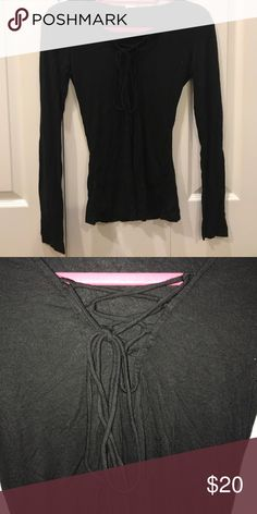 Black lace up long sleeve Adorable black long sleeve with a lace up neck!! Tops Tees - Long Sleeve