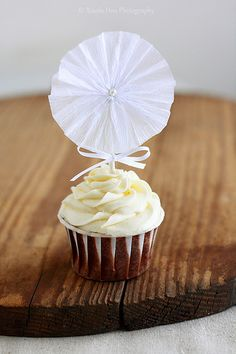Crepe Paper Rosette Cupcake Toppers by Xiaolu // 6 Bittersweets, via Flickr