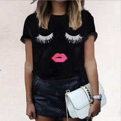 Adorable Black Eyelash Tshirt Size large eyelash black tee. Is from a boutique so there is no brand. Bundle for discount. Boutique Tops Tees - Short Sleeve