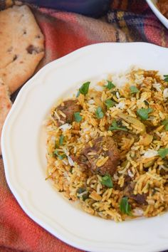 A baked casserole of basmati rice and tender lamb that's flavoured with a fragrant Indian curry paste is great teamed up with lots of tasty side dishes.