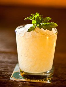 Añejo Smash      1½ oz. añejo tequila    ½ oz. Grand Marnier    ¾ oz. agave syrup    6-8 fresh mint leaves    4 lemon wedges    Ice cubes    Crushed ice    Tools: shaker, strainer    Glass: rocks    Garnish: fresh mint sprig        Combine all ingredients in a shaker with ice. Shake, strain into a rocks glass packed with crushed ice and garnish.