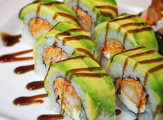 American Dream Roll: Spicy Crab, Cream Cheese, Shrimp Tempura garnished with avacado