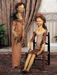"Rare Early Wooden Lady Doll with Sculpted Bodice. 27"". Wood doll w one- piece head & torso, carved eye sockets, painted facial feature, blue eyes, painted lashes & brows, hair wig, dowel jointing at shoulders, elbows, hips & knees, painted orange slippers. Late 18th century, Continental. Original dress with delicate crewel embroidery."
