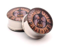Steampunk Clock Picture Plugs Style 2 gauges - 2g, 0g, 00g, 7/16, 1/2, 9/16, 5/8, 3/4, 7/8, 1 inch. $19.99, via Etsy.