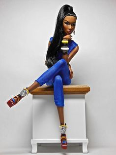 A real beauty of a Barbie in bright blue.... And look at those shoes! Tinyfrockshop.com