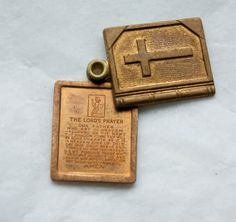 1 Vintage 1960s Sliding Brass Bible Pendant with Lord's Prayer Inside. $3.75, via Etsy.