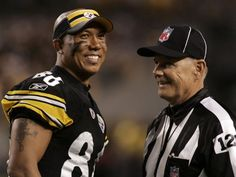 Hines Ward having a laugh with the ref.