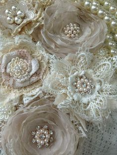 layering lace and organizer to create these flowers makes them appear beautiful and delicate, delicate embellishment with pearl beads makes them rich.