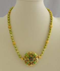 http://www.adhicreations.com/products/298-pear-green-cloisonne-set.aspx  Pear Green Cloisonne Set  One of its kind Necklace jewelry set made of some of the unique type of beads. The center piece is the artistically hand crafted Cloisonné bead with vibrant enamel coating. The bright artwork is found on both sides of the focal piece and golden color edges forms a nice contrast adding beauty.  Product ID : N1038  Availability: In stock  $30.00 (USD)