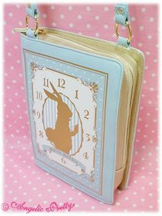 A Sweet Lolita in Debt: Lolita Bags that look like Books, So Cute! WISH LIST! I love this bag, in fact, and book bag! But an alice in wonderland themed one? Ohhh yes!