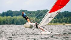 trapez sailing on a topcat k3 at the lake cospuden, near leipzig.  sailor: marcus viefeld photo by eckhard scheibler