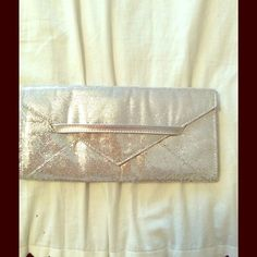 ⭐️Price Lowered⭐️Victoria's Secret Sparkle Clutch NWOT - This clutch is perfect to add a pop of sparkle for a night on the town. Never been used. Victoria's Secret Bags Clutches & Wristlets