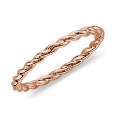 Not usually a fan of gold, but rose gold has such an interesting hue and I like the twists. Nice touch to a navy or green and white outfit.
