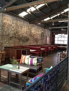 "Middle Fish cafe, Carlton. Interior designed by Thai Artist Torlarp Larpjaroensook includes ""thoughtful, creative, handmade interior that includes a chandelier made from ceramic bowls, a long steel bench for eating, exposed brick walls and an indoor bicycle parking."""