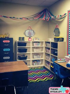 Ceiling ribbon canopy in corner of classroom.  Chevron rug.  Math manipulative center.