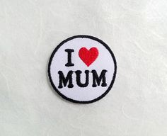 I Love MUM Iron on Patch ---------------------------------------------------- Quantity : 1 Piece Diameter : Approx 4.1 cm ** The actual color of item may vary slightly from that shown on your screen.  ✚ See more Iron on Patch in my store, please click ✚  https://www.etsy.com/your/shops/PoohmieCollection/tools/listings/section:17732662,stats:true . HOW TO USE  1. Spray water on the back of embroidery 2. Place embroidery on garment 3. Set iron temperature...