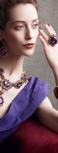 Big Ass purple amethyst set in a gold ring. Large amethyst stones set in a beautiful gold necklace. All to set off the purple lunging neckline on the dress.  Oscar de la Renta Crystal Earrings, Necklace & Cuff